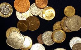 Eine Handvoll Münzen aus aller Welt kann viel Hilfe bewirken